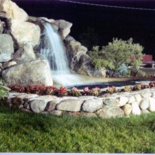 nighttime waterfall mini golf course design
